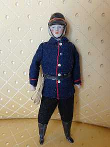 Antique dollhouse-firefighter, dated about 1910.