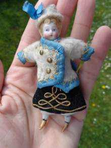 Antique bisque doll, a cute Russian lady, made about 1900.