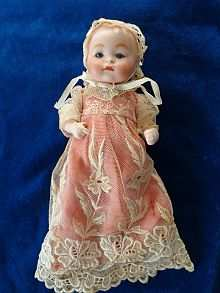 Antique doll baby with closed mouth and small blue glass eyes, Theodor Recknagel, made about 1920.