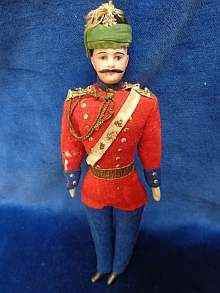 Antique dollhouse man, rare bisque head officer, dated about 1900.