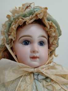 Antique French Depose tete Jumeau doll, closed mouth, dated about 1885.