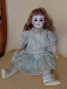Beautiful antique doll, with open-closed mouth, dated about 1880.