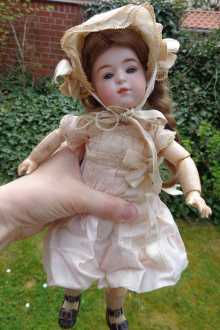 German antique character doll, a lovely girl with closed mouth, dated about 1900.