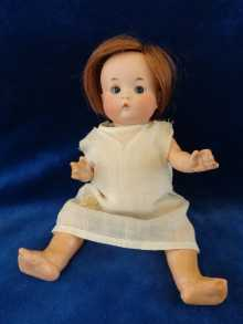 Antique doll, cute Just ME doll with closed mouth and small blue glass sleep eyes, made by Armand Marseille.