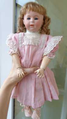 Antique doll, beautiful character doll with closed mouth made by Swaine & Co., dated about 1910.