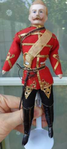 Antique doll, rare doll officer with original antique uniform and sword, dated about 1900.